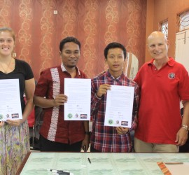BOCS recipient, Victor Samudra (second from right) signs his scholarship agreement