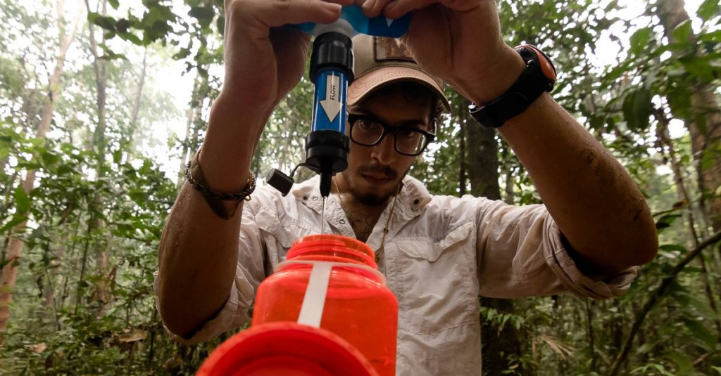 Robert filters water for drinking.  Photo © Robert Rodriguez Suro